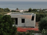 One of the many houses being built quickly on the Ionian coast